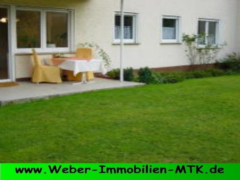 Immobilienmakler in Kriftel TOP Lage in Marxheim, EG-Wohnung mit SONNEN-Terrasse, eigenem GARTEN, TGL-Wannenbad in kleiner WE